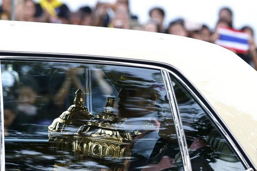 Thai King Maha Vajiralongkorn and Thai Princess Maha Chakri Sirindhorn carrying the royal relics and the ashes of the late Thai King Bhumibol Adulyadej during the procession to the temples, where they will be laid to rest, on Oct 29, 2017.