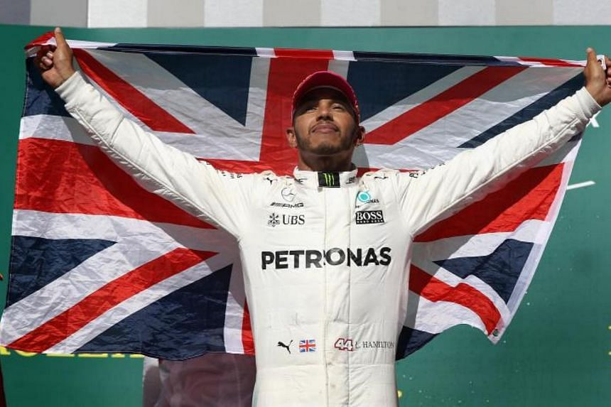 Mercedes driver Lewis Hamilton celebrates during the United States Formula One Grand Prix at Circuit of The Americas in Austin, Texas, on Oct 22, 2017.