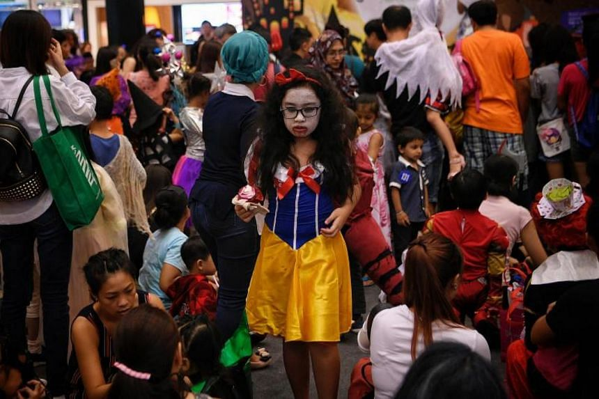 Contestants preparing to join the costume contest at the Halloween Mayhem event in Seletar Mall on Oct 29, 2017.