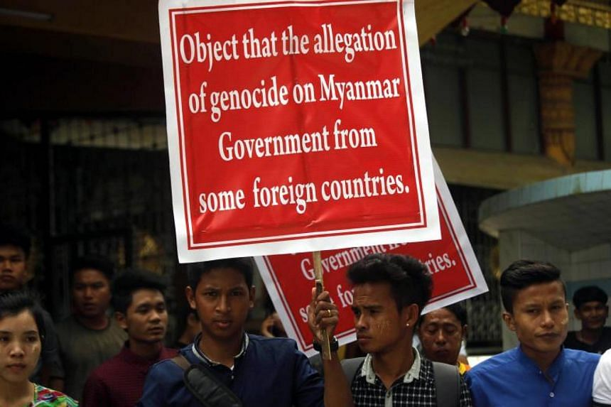 Protesters holding placards during a demonstration in Sittwe, Rakhine state, on Oct 22, 2017.