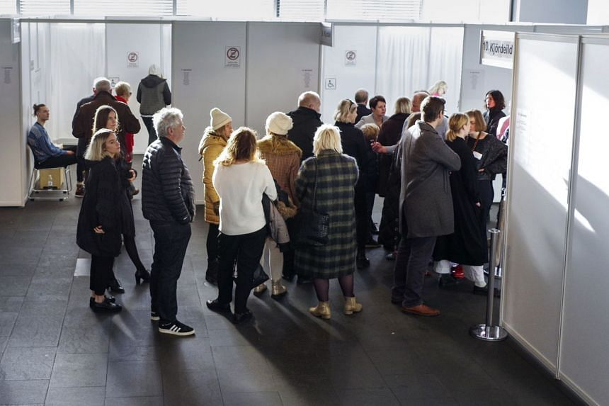 People waiting to cast their votes during a snap parliamentary election in Reykjavik, Iceland, on Oct 28, 2017.