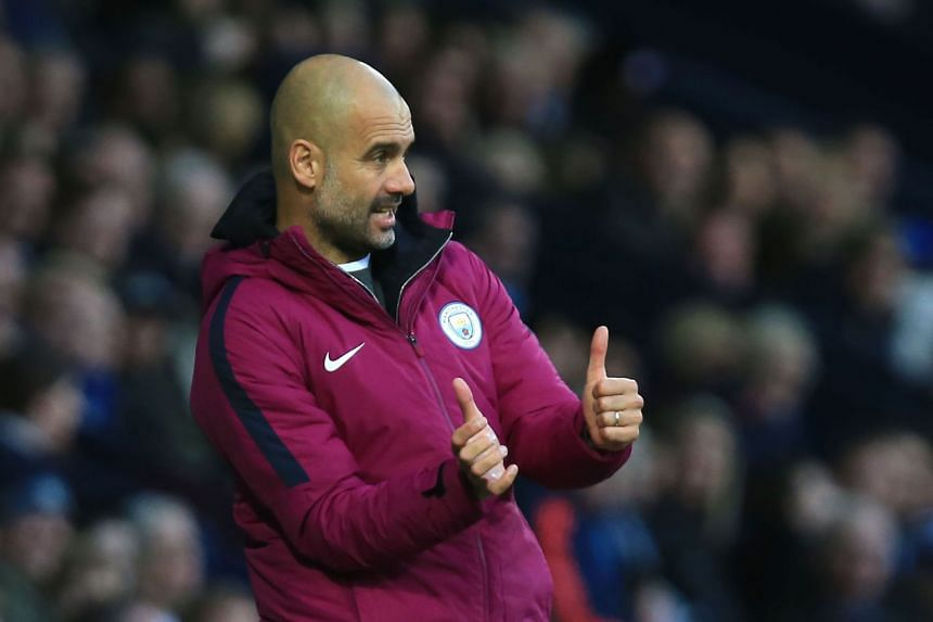 Pep Guardiola gestures during the match.