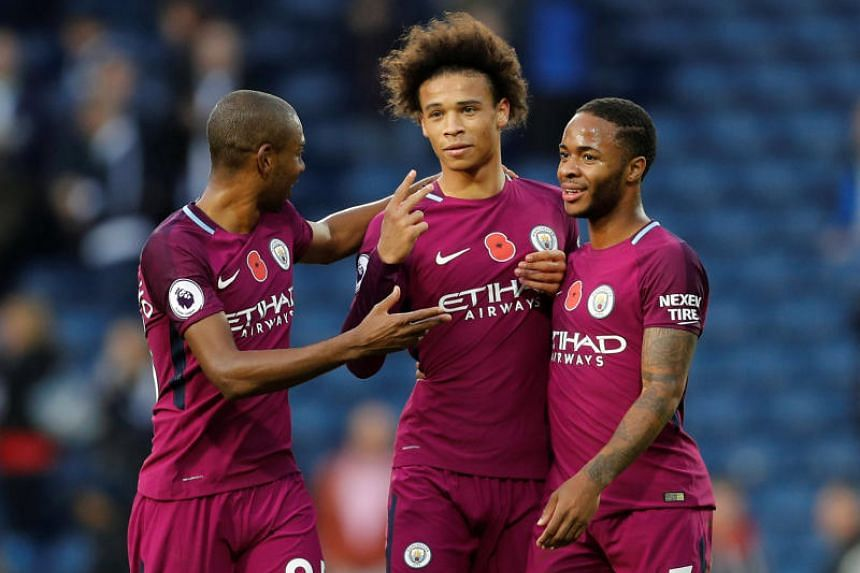 Manchester City's Fernandinho, Leroy Sane and Raheem Sterling celebrate after the match.