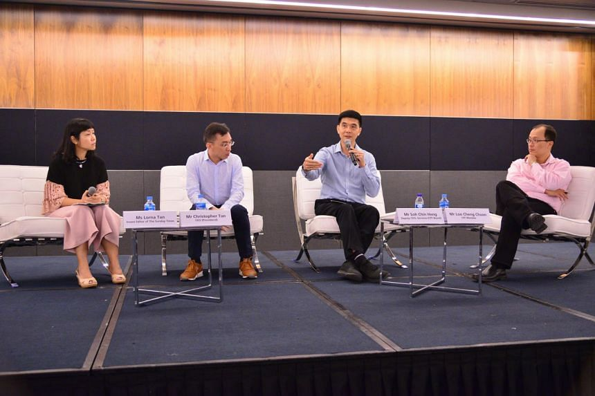CPF Board deputy chief executive (services) Soh Chin Heng speaking at the Maximising Your Money session moderated by The Sunday Times' Invest editor Lorna Tan. The other panel speakers were Providend chief executive Christopher Tan and CPF member L