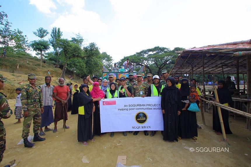 Mr Muhammad Firdaus and his wife Najihah Jofrie (centre, in neon vests) in Bangladesh for the aid mission.