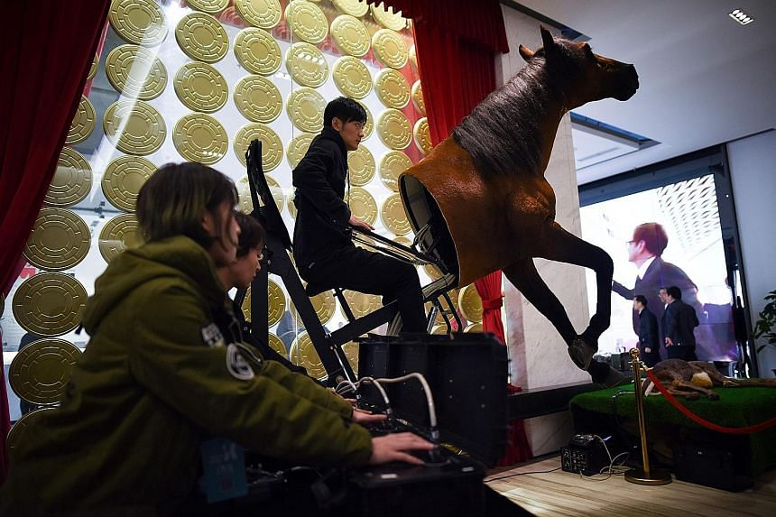 A film crew in Dachang county controlling the model of a horse last week.