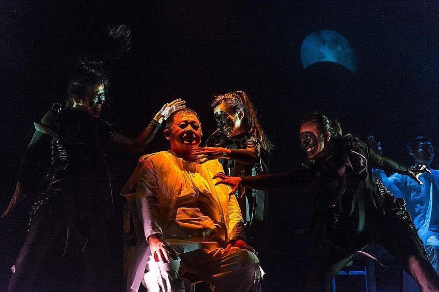Actor Johnny Ng (in white) is surrounded by three phantoms played by (from left) Myra Loke, Jo Kwek and Jasmine Xie in The Spirits Play.
