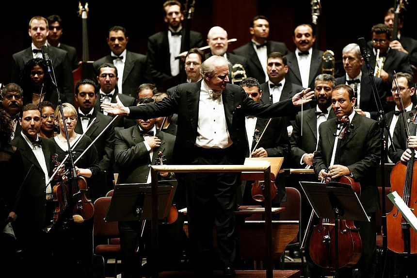 Conductor Leonard Slatkin (left, with the Iraqi National Symphony Orchestra) will lead a number of works to remember Leonard Bernstein next year.