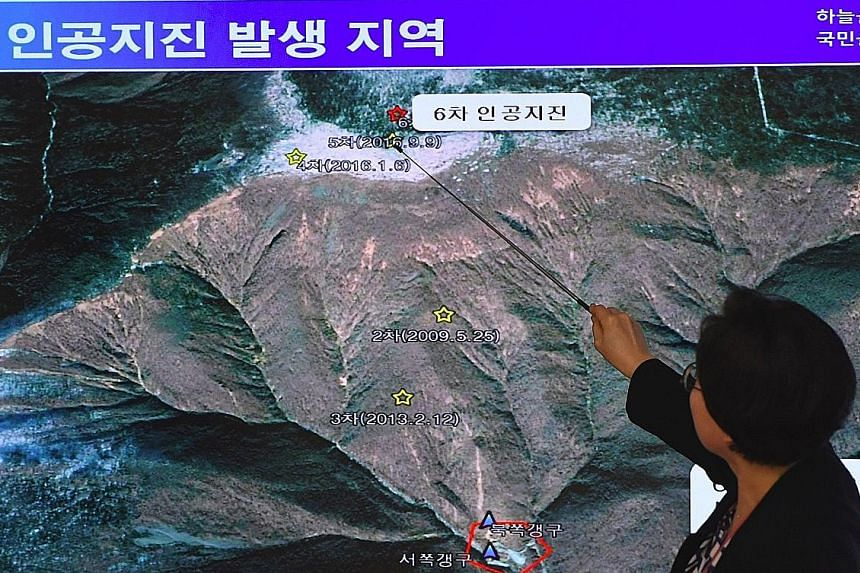"""Ms Lee Mi Seon of South Korea's National Earthquake and Volcano Centre showing on Sept 3 showing the site of an """"artificial earthquake"""" in the North said to have been caused by a nuclear test."""