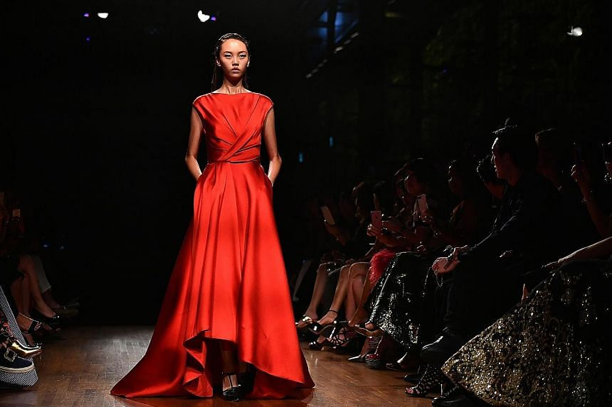 Taiwan-born designer Jason Wu's runway show (above) at Singapore Fashion Week was held at the National Gallery Singapore's Supreme Court Terrace. Outfits by Singapore label Feayn (top) and Indonesian designer Dian Pelangi (above) were also featured.