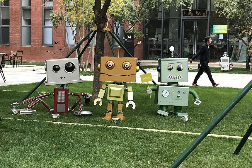 As of this month, 38 movie and TV-related companies have started operations in Dachang (above). At Xianghe (left), more than 30 robot-makers have started operations.