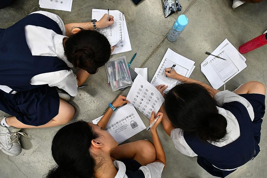 PLMGS students hard at work writing coded messages in school last Monday. They were learning cryptology - the art of encrypting messages so that only the intended recipients can decipher and read them.