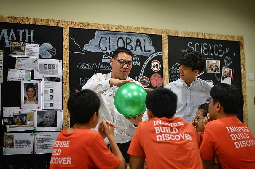 Coder Turner Lam (far left) and user experience designer Louis Phua are among the industry experts SIM International Academy has hired as part of the school's Stem programme.