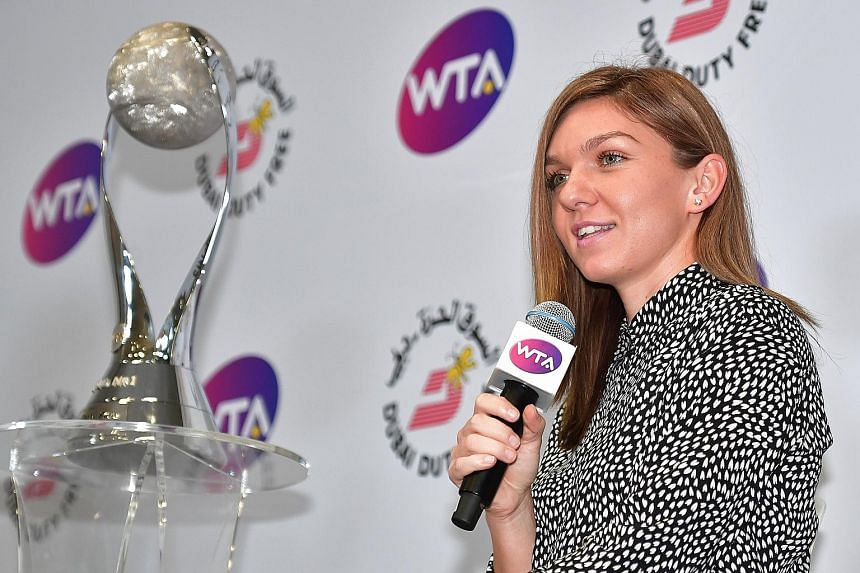 Earlier in the day, Simona Halep of Romania, who has taken the year-end world No. 1 ranking, received her trophy easing her pain of not qualifying for the semi-finals here.