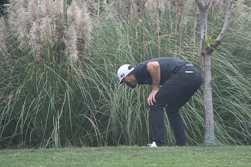 Left: A kiss from a Rose as Justin celebrates his two-shot win at the WGC-HSBC Champions yesterday. Below: A horrible final round for world No. 1 Dustin Johnson, seen looking for his ball in the rough. He had been bidding to become the first man to w