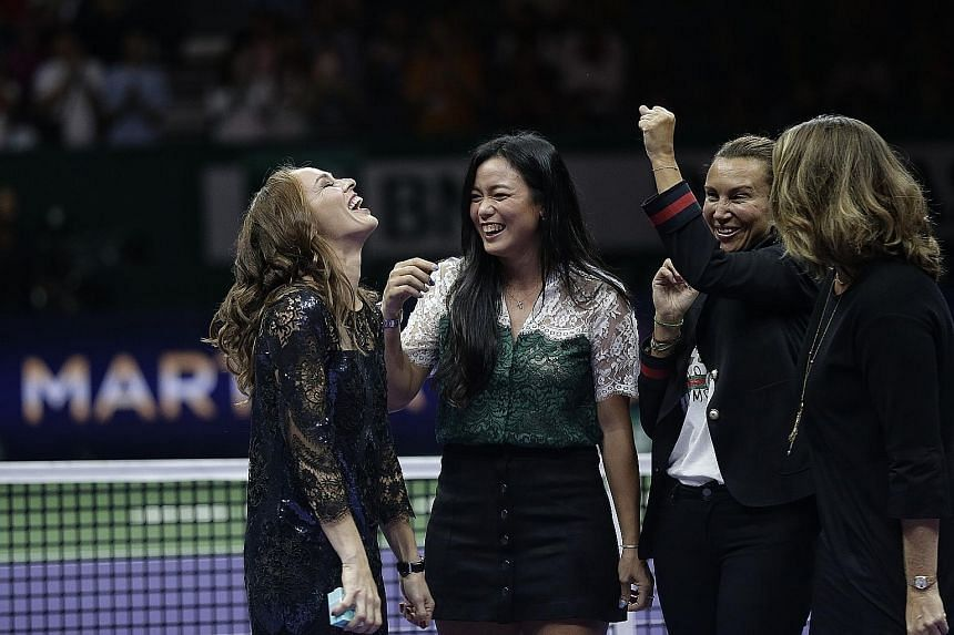 Clockwise from above: Czech Andrea Hlavackova (left) and Hungarian Timea Babos beat Dutchwoman Kiki Bertens and Swede Johanna Larsson 4-6, 6-4, 10-5 to win the WTA Finals doubles title yesterday at the Singapore Indoor Stadium. The pair, making their