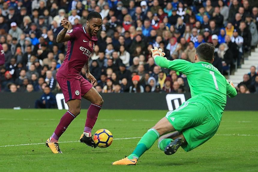Manchester City winger Raheem Sterling slotting past West Brom 'keeper Ben Foster at The Hawthorns for their third goal on Saturday. The table-toppers have been in imperious form since the start of the season, garnering 28 points out of a possible 30