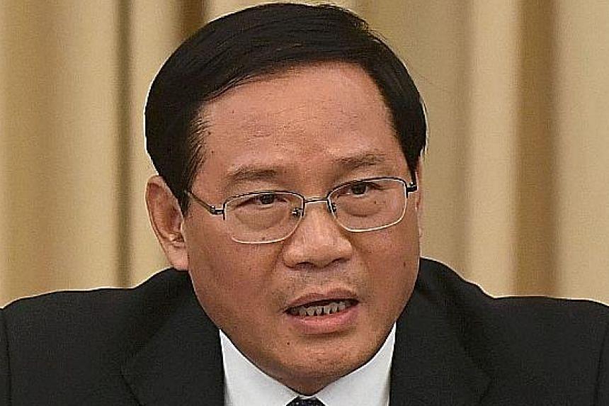 Mr Li Qiang (left), the former Jiangsu party boss, replaces Mr Han Zheng, who joined the elite PSC last week.