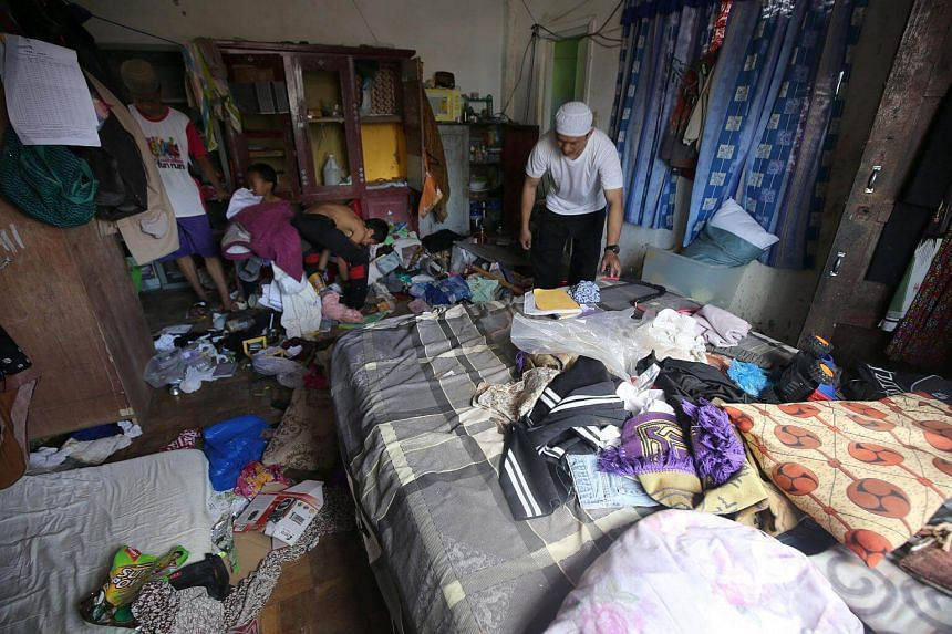 Residents who stayed at evacuation centers start cleaning their house after they were allowed to return to Basak, Malutlut district in Marawi city, Philippines.