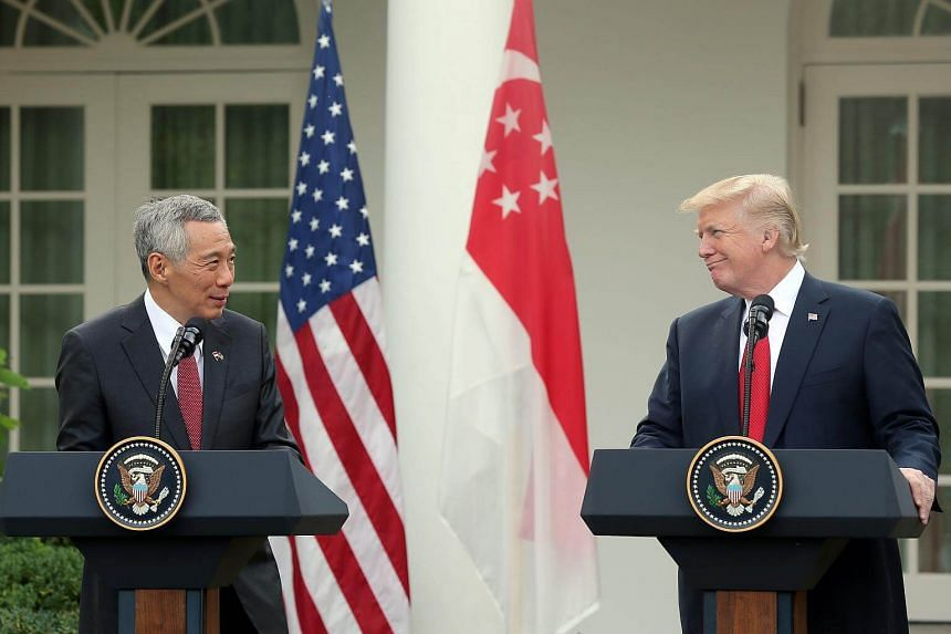 US President Trump and PM Lee during a press conference at the White House Rose Garden.