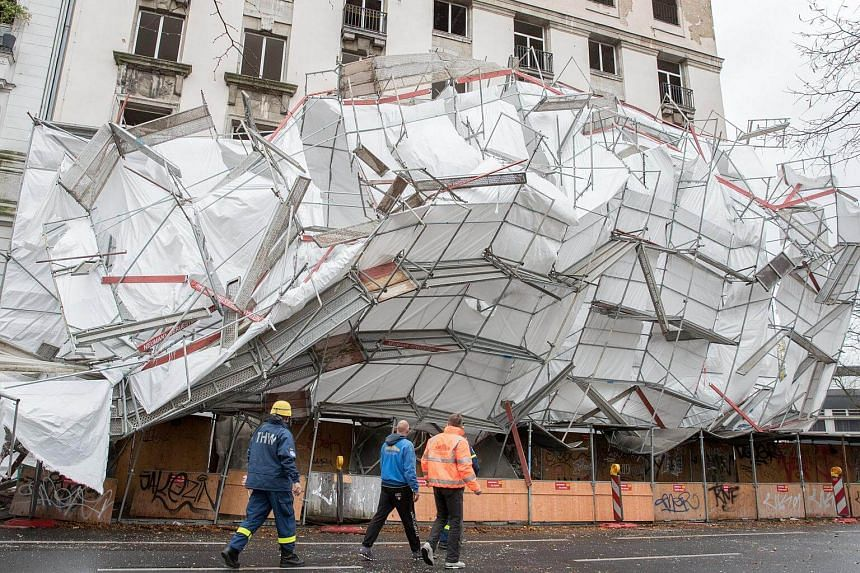 Emergency workers in front of collapsed scaffolding due to heavy winds in Berlin.