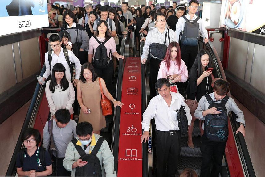 Passengers are seen during rush hour at a skytrain station in Bangkok, Thailand.
