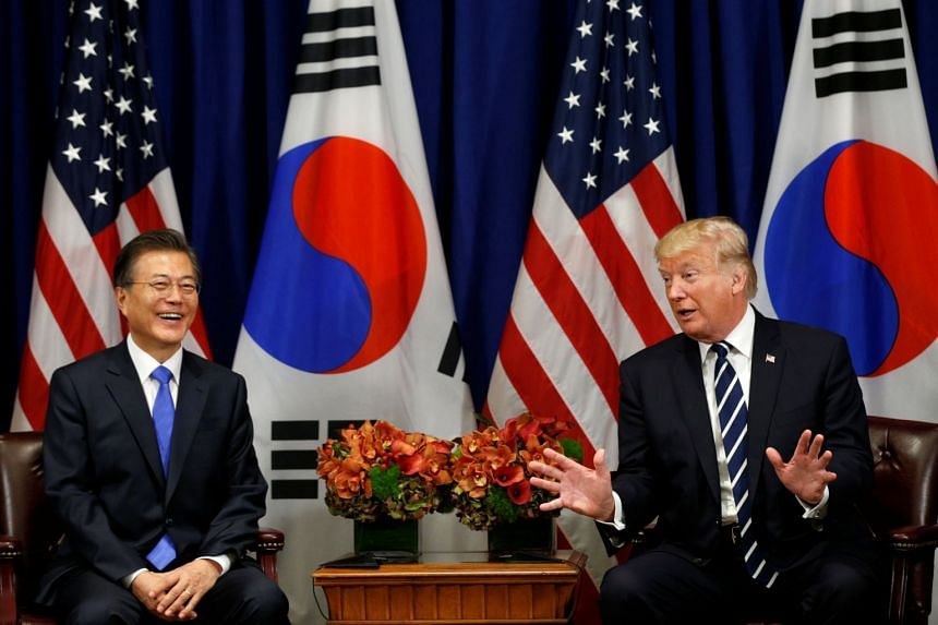 US President Donald Trump speaking with South Korean counterpart Moon Jae In during the UN general assembly in New York, on Sept 21, 2017.