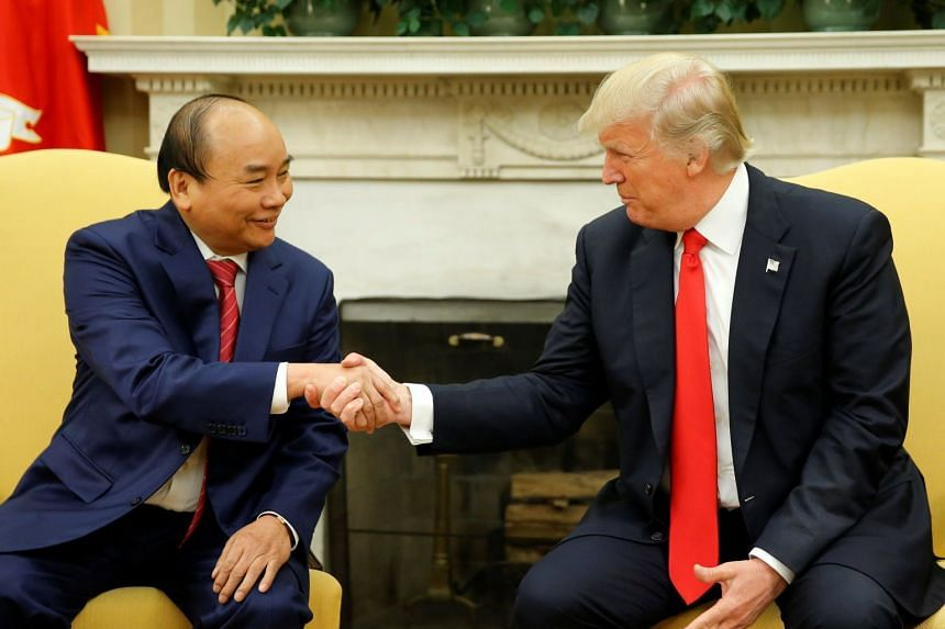 US President Donald Trump welcoming Vietnam Prime Minister Nguyen Xuan Phuc at the White House on May 31, 2017.