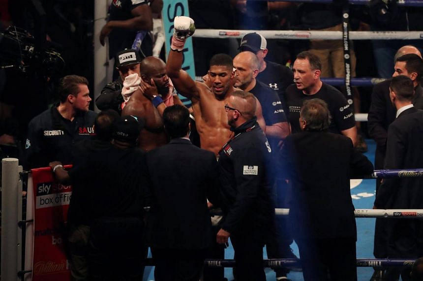 Anthony Joshua celebrates at the end of the fight at the Principality Stadium in Cardiff, Britain, on Oct 28, 2017.