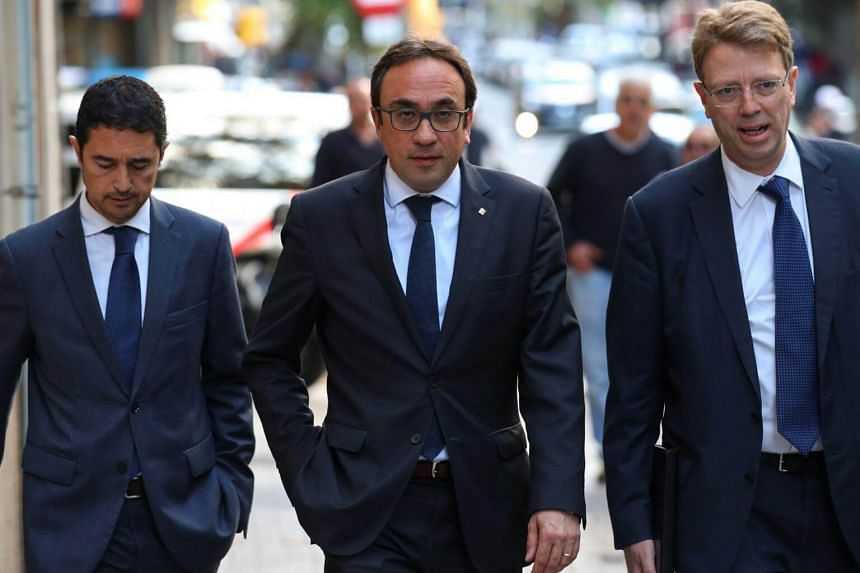 Mr Josep Rull i Andreu (centre) arrives to a PdeCat (Catalan Democratic Party) meeting in Barcelona, on Oct 30, 2017.