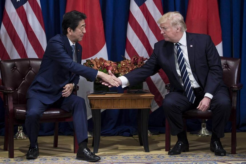 Japan's Prime Minister Shinzo Abe and US President Donald Trump at the Palace Hotel during the 72nd United Nations General Assembly on Sept 21, 2017.