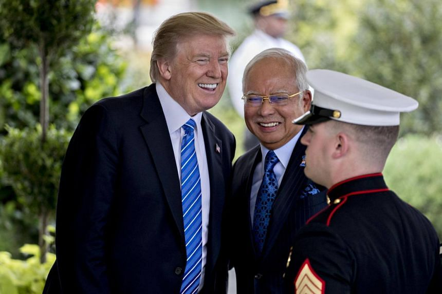 US President Donald Trump with Malaysia's Prime Minister Najib Razak at the West Wing of the White House in Washington, DC, on Sept 12, 2017.