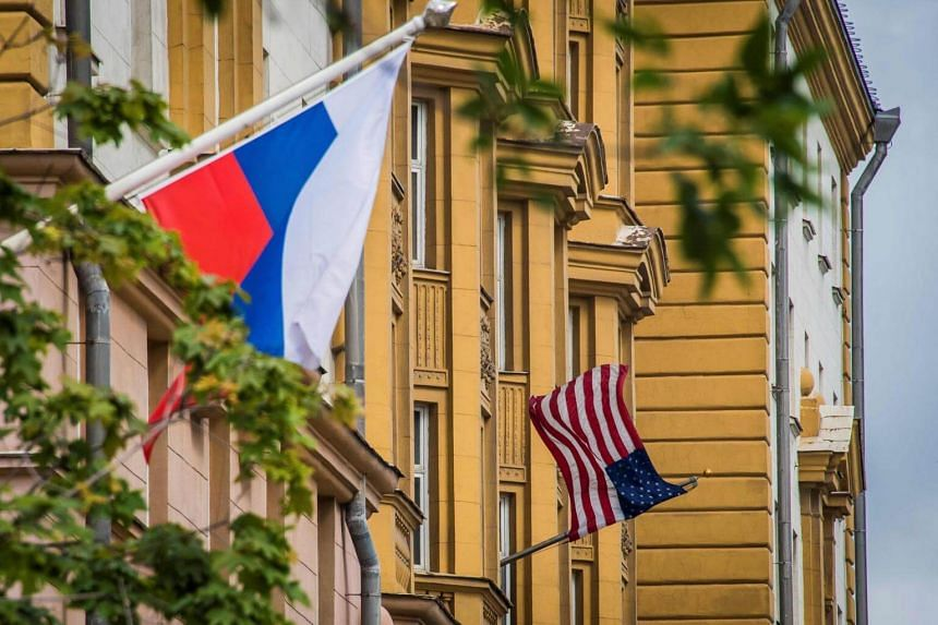 A Russian flag flies next to the US Embassy in Moscow.
