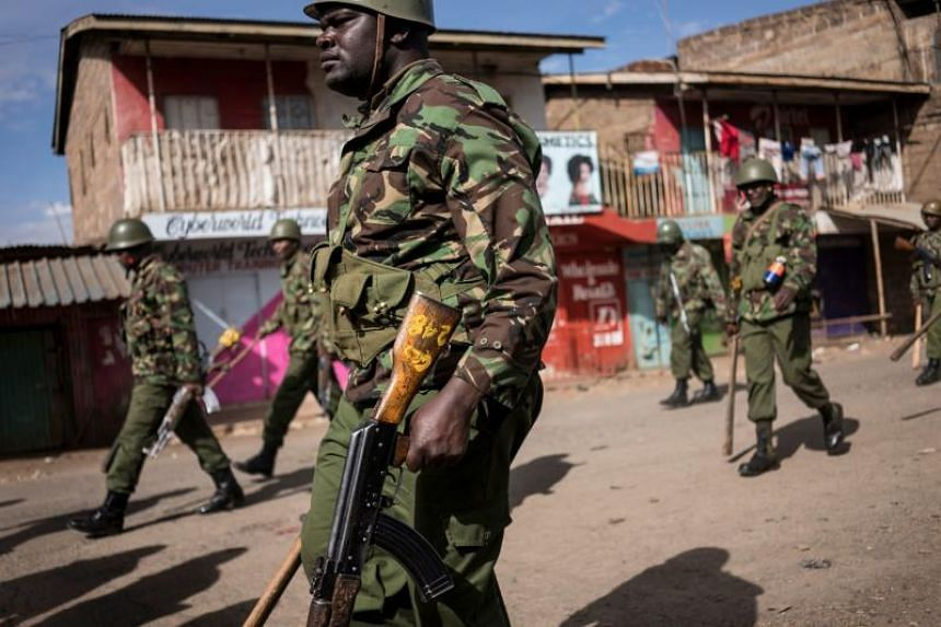 Officers of the Kenyan General Service Unit, a paramilitary unit of the National Police Service of Kenya, patrol in the streets of the Kawangware slum in Nairobi, on Oct 29, 2017.