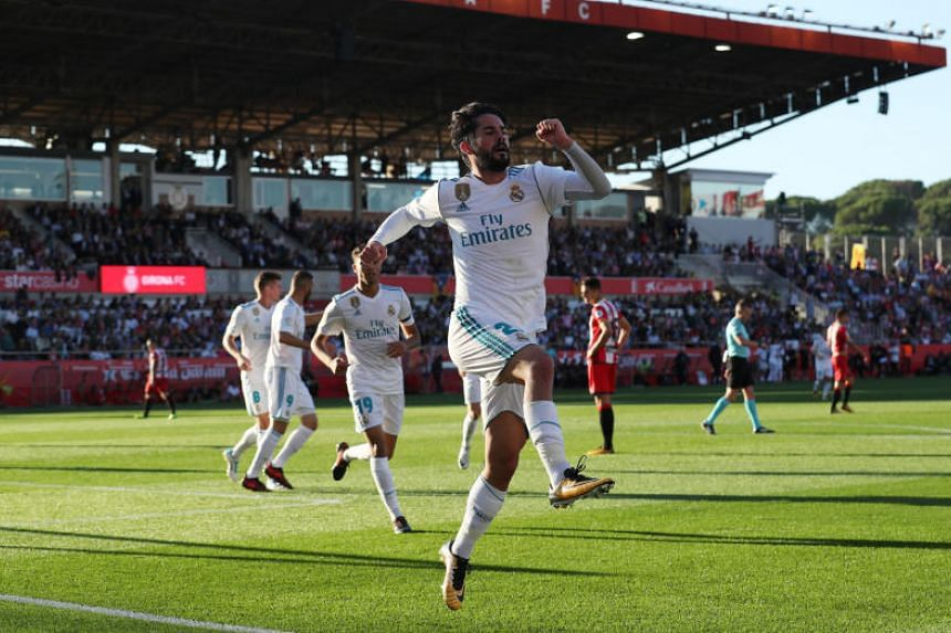 Real Madrid's Isco celebrates scoring their first goal against Girona in the Estadi Montilivi, Girona, Spain on Oct 29, 2017.
