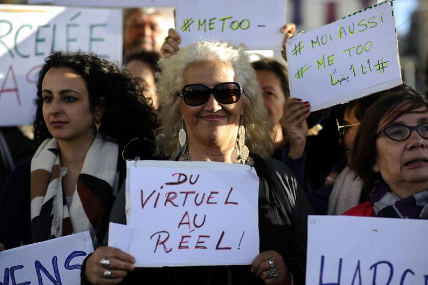 Women hold placards as they gather for a rally at the Old Port of Marseille, southern France, on Oct 29, 2017, to denounce harassment and sexual violence in everyday life.