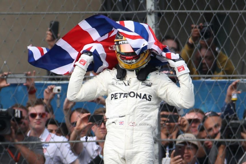 Mercedes' Lewis Hamilton celebrates after winning the Mexican Grand Prix 2017 on Oct 29, 2017.