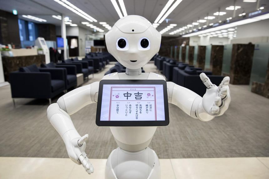 A Pepper humanoid robot, developed by SoftBank Group Corp., stands inside the Mizuho Financial Group Inc. headquarters in Tokyo, Japan.
