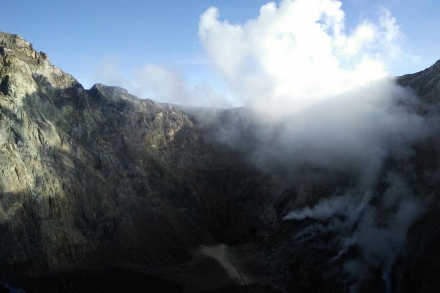 Volcanic activity in Mount Agung is slowing and the volcano's status has been lowered by Indonesia's volcanology centre.
