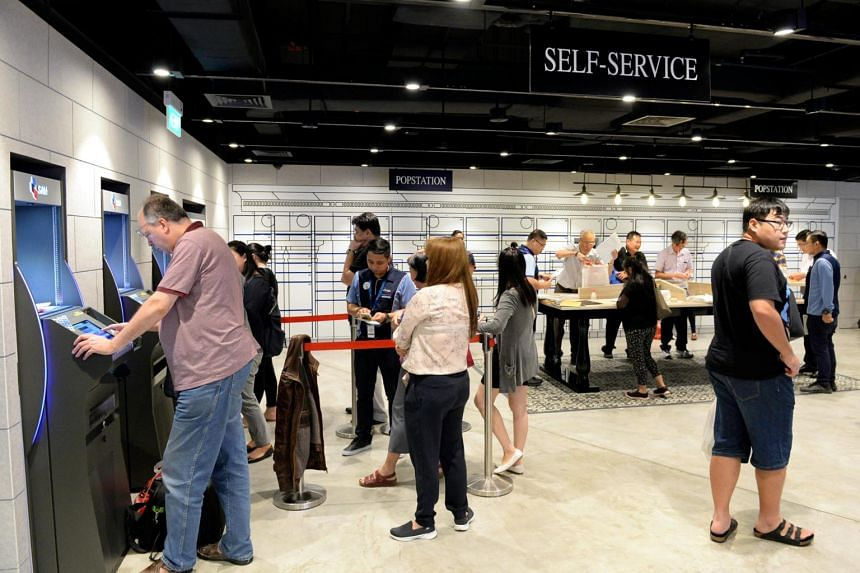 Customers in the General Post Office (GPO) at SingPost Centre. Shopping centres like Century Square, Funan Mall and SingPost Centre have embarked on aggressive asset enhancement works, said Cushman & Wakefield research director Christine Li.