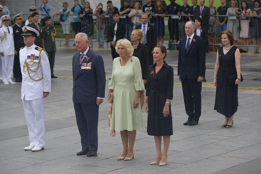 The Prince of Wales and the Duchess of Cornwall observe a minute of silence at the Cenotaph.
