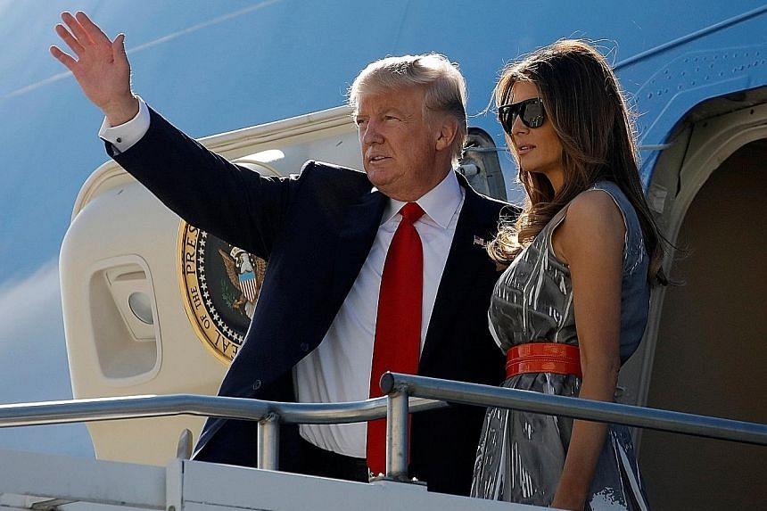US President Donald Trump and his wife Melania boarding Air Force One in Hamburg, Germany, in July. Mr Trump's first stop in Asia next week is Japan.