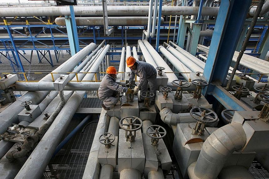 Employees at a PetroChina refinery in Lanzhou, Gansu province, China. Ten years after PetroChina peaked on its first day of trading in Shanghai, the state-owned energy producer has lost about US$800 billion (S$1.09 trillion) of market value.