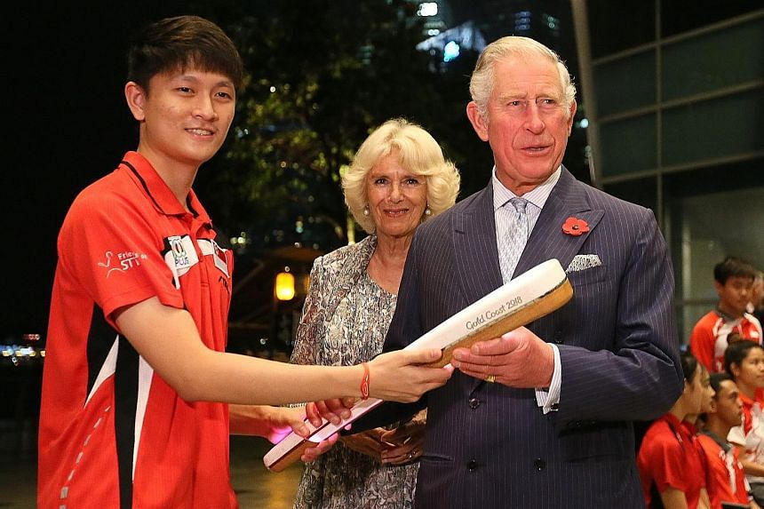 Britain's Prince Charles received the Commonwealth Baton from national table tennis player Clarence Chew, 21, last night, while his wife Camilla, the Duchess of Cornwall, looked on. The royal couple, who are here on an official visit, met Mr Chew, a