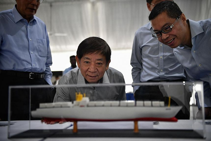 Mr Khaw Boon Wan with managing director of Singapore Terminals 1, Mr Cheang Chee Kit, viewing a 3D printed ship.