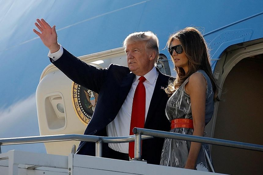 """President Donald Trump and his wife departing from Hamburg, Germany, in July. The First Lady will accompany him on """"at least part"""" of the Asia trip, said the White House."""