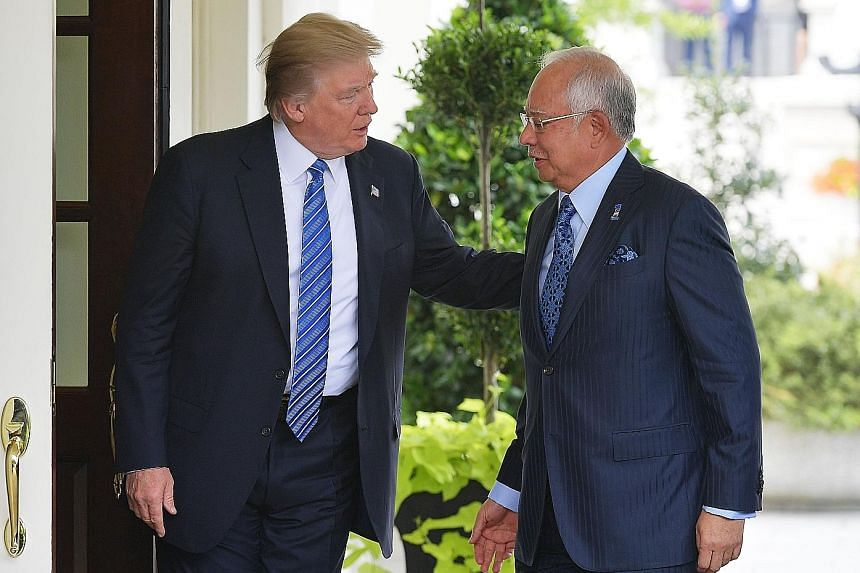President Donald Trump greeting Prime Minister Najib Razak outside the West Wing of the White House on Sept 12. The Malaysian opposition allege that Mr Trump did not want to meet Datuk Seri Najib due to the ongoing US probe into state fund 1Malaysia