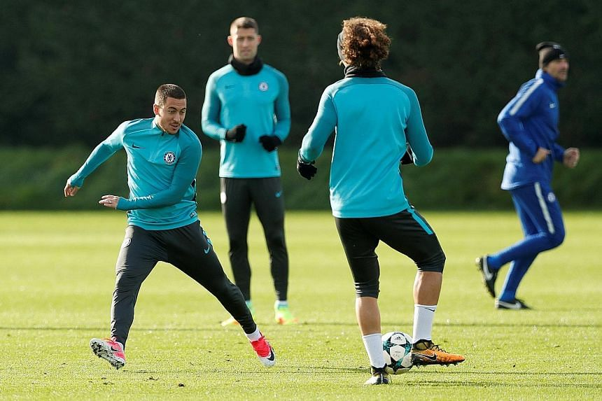 From left: Chelsea's Eden Hazard, Gary Cahill and David Luiz during training. The team face Roma away in their bid to qualify for the Champions League knockout stages before hosting Manchester United in a crack Premier League tie at the weekend.
