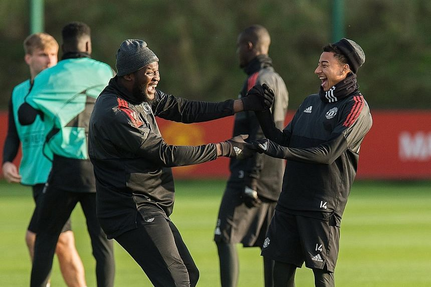Manchester United's Romelu Lukaku and Jesse Lingard are all smiles in training ahead of today's home tie against Benfica. The Belgian striker will be hoping to end a three-game run without a goal against the rock-bottom Portuguese side at Old Traffor
