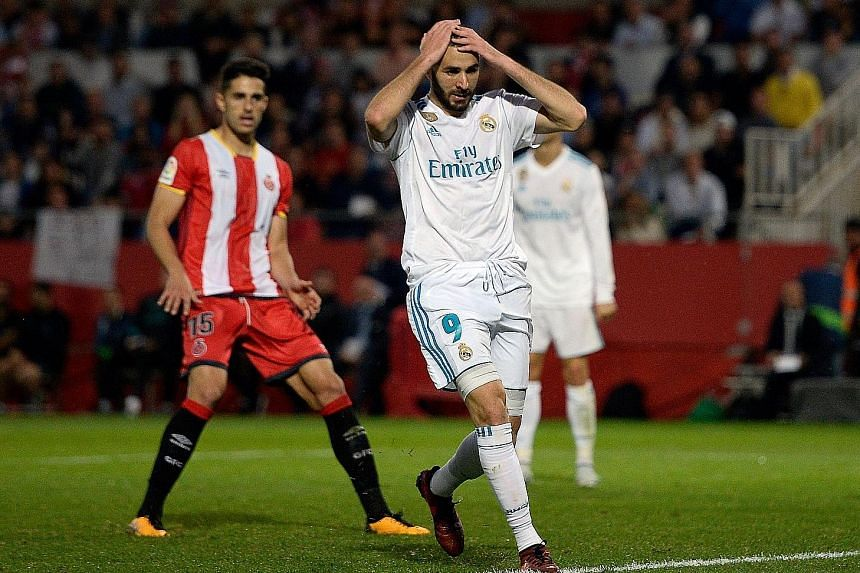 Real Madrid's Karim Benzema castigating himself after missing a chance during their 1-2 loss to Girona. To compound matters, Raphael Varane may miss Wednesday's Champions League tie at Spurs, having suffered an injury during the away defeat.